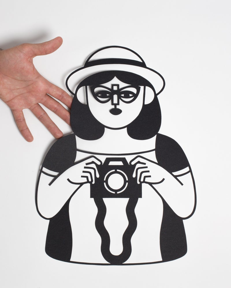 Image of PAPERCUT GIRL TAKING PICTURES
