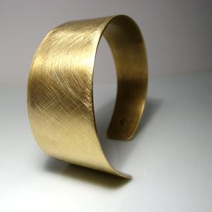 Image of asymmetrical cuff. bracelet. brass.