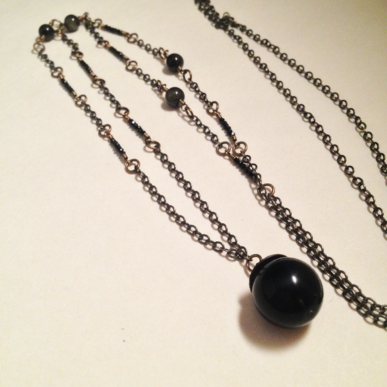 Image of The Magician Golden Obsidian Black Garnet Gemstone Dark Crystal Ball Necklace | Witch Tarot Jewelry