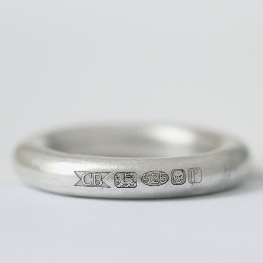 Image of handmade silver ring with feature hallmark ring