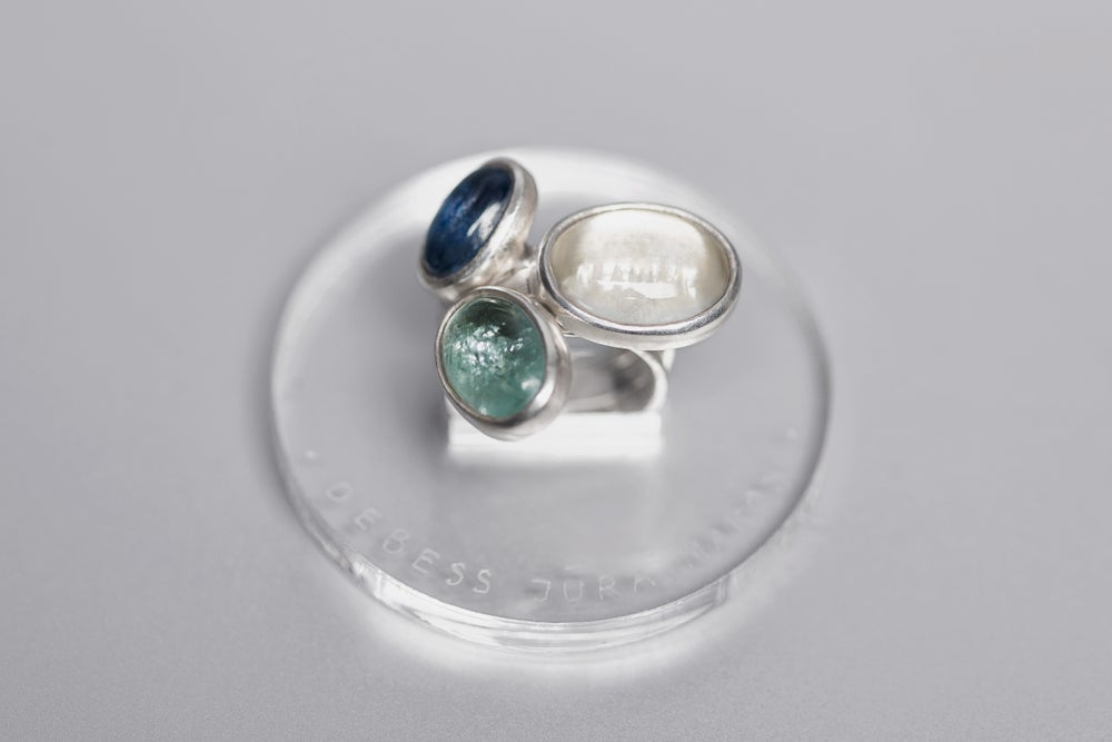 Image of silver rings with aquamarine, rock crystal and kyanite CAELUM, MARE, NEBULAE