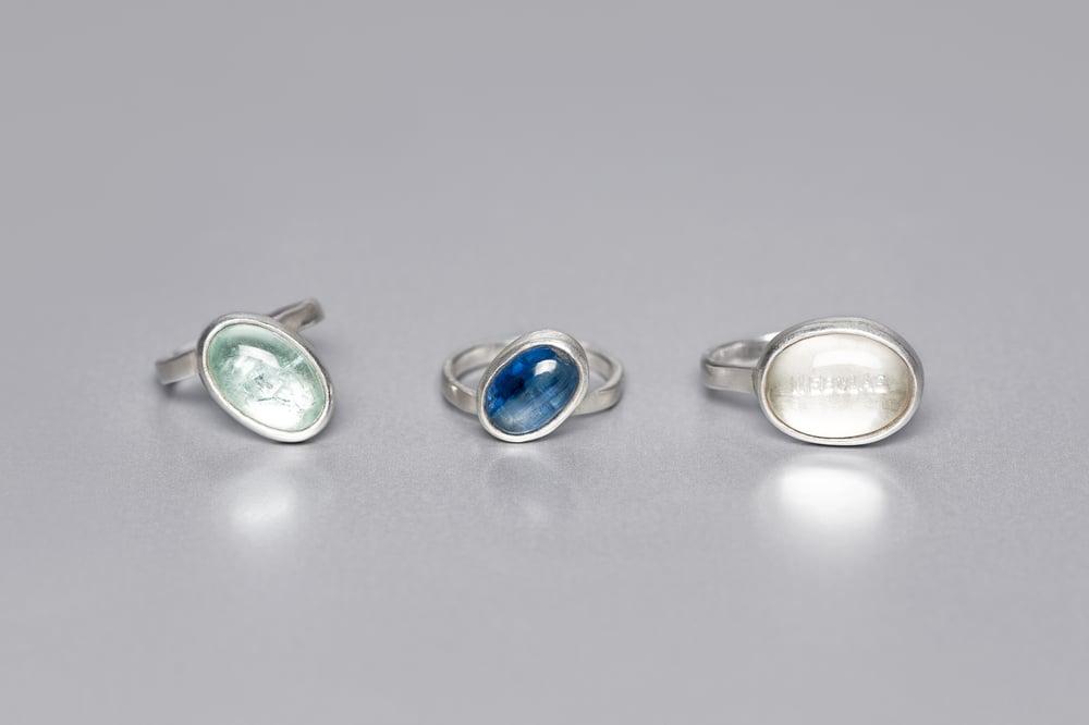 Image of silver rings with aquamarine, rock crystal and kyanite CAELUM, MARE, NEBULAE