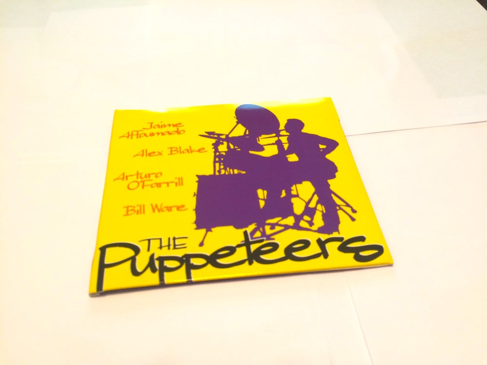 Image of THE PUPPETEERS (2014)