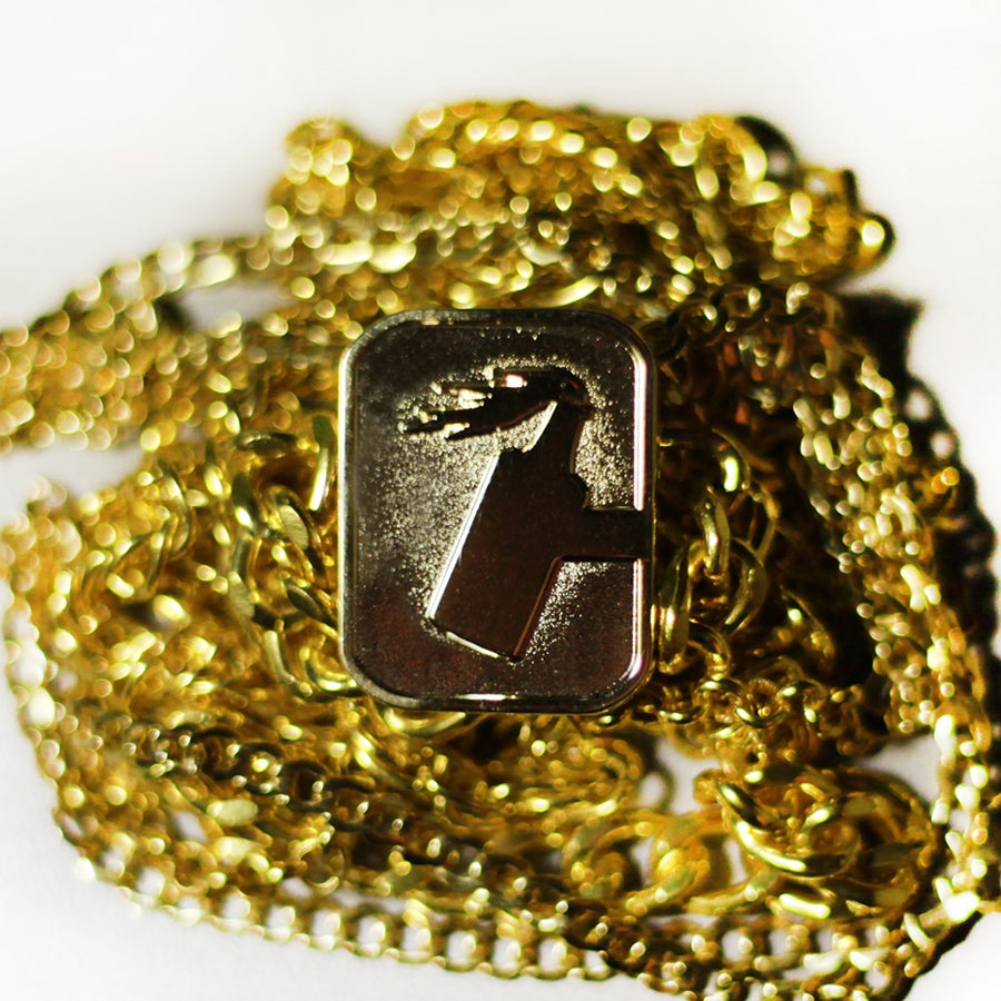 Gold C logo Pin