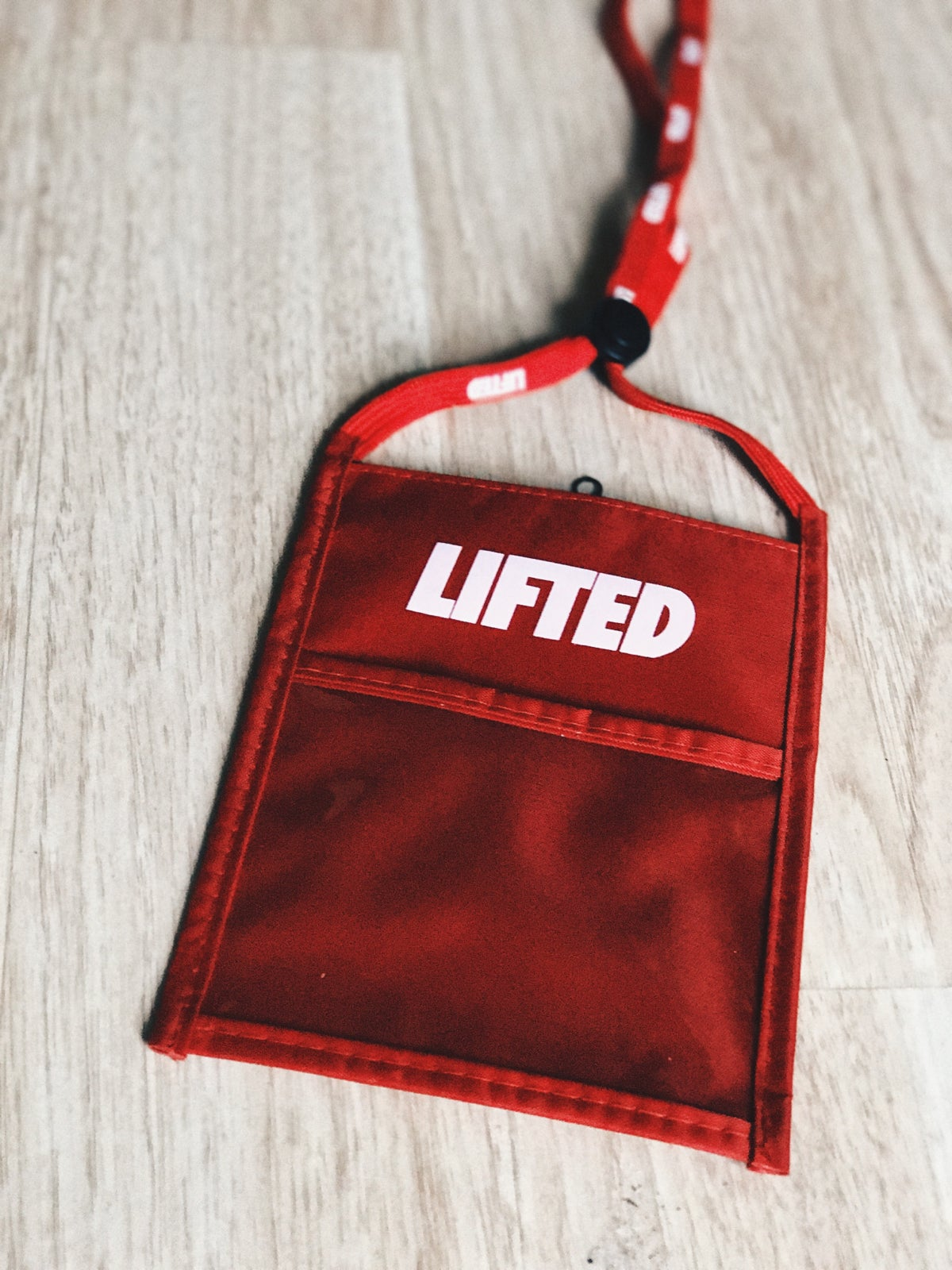 Image of Lifted Colored Neck Wallets