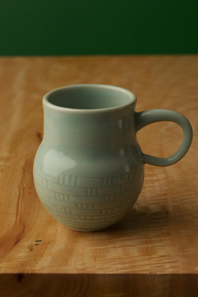 Image of Hand Thrown Mugs in DNA Pattern