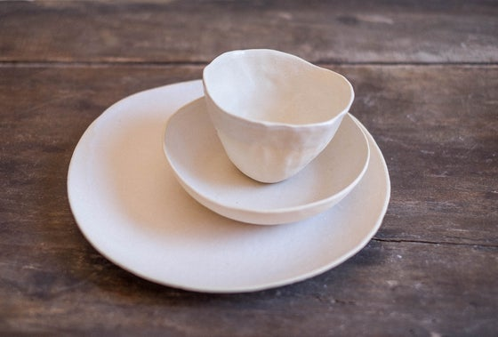 Image of Set comida blanco roto con textura