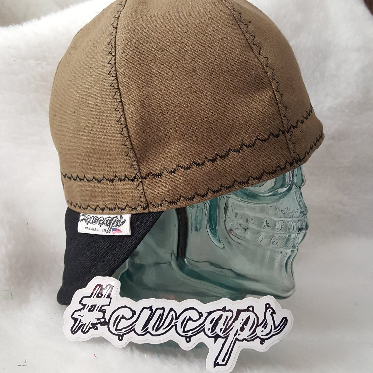Image of Brown Welders Cap with Black Carhartt Bill.