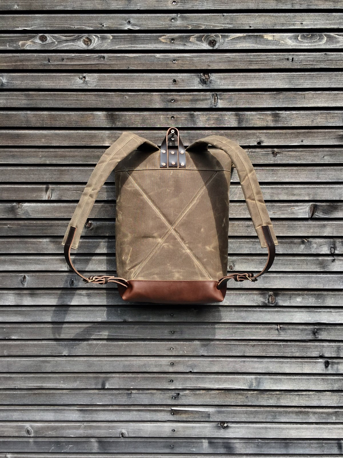 Image of Waxed canvas backpack / rucksack with leather outside pocket and bottom, unisex
