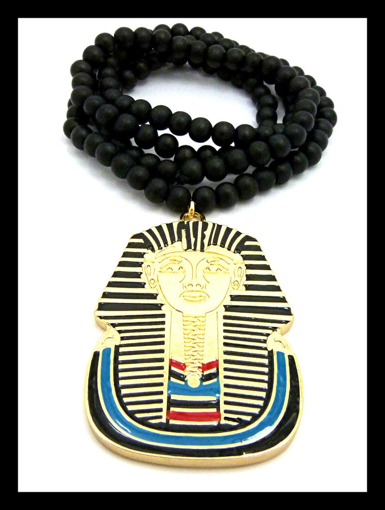 Image of GOLD-TUT-PENDANT-BLACK-BEADS