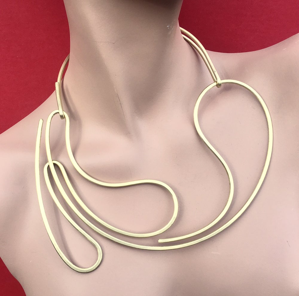 Image of Viscoelastic Splash Resists Time-Dependent Strain, Just Like Blood and Honey Do, Necklace