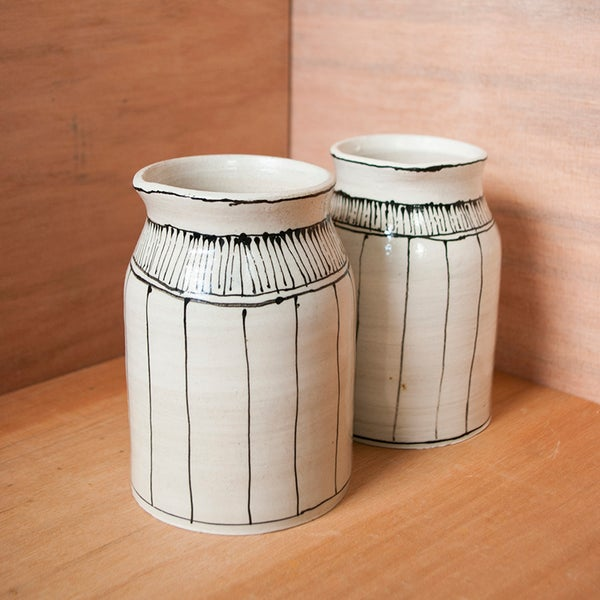 Image of Grid milk jugs