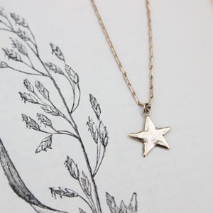 Image of star necklace in gold or silver