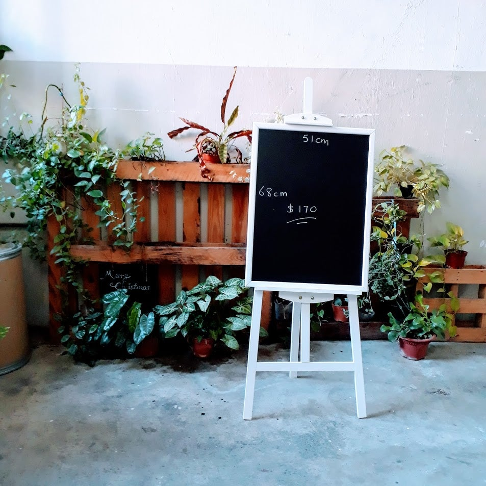 Image of Big Chalkboard with White Frame on White Easel