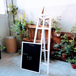 Big Chalkboard with White Frame on White Easel
