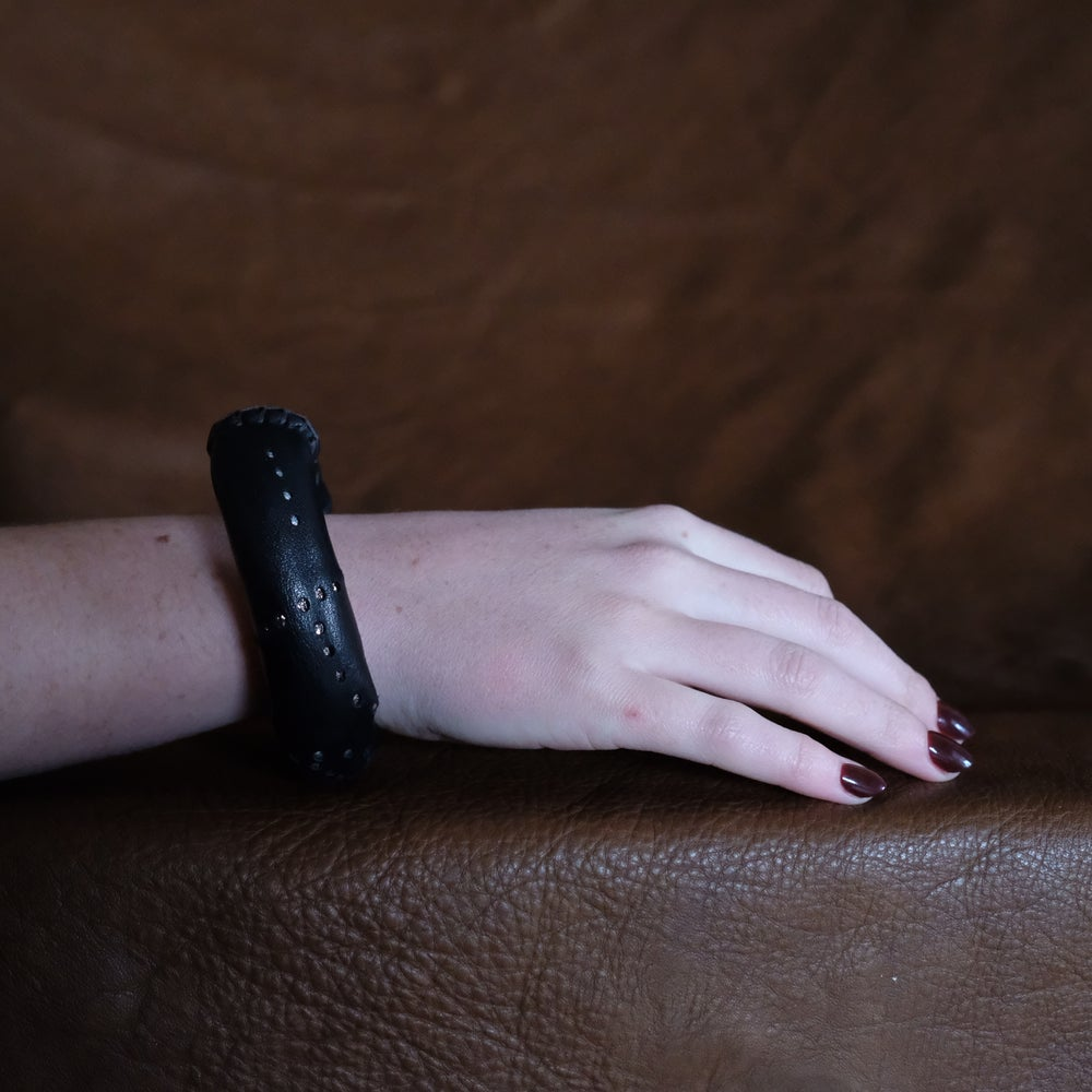 Image of L Bracelet in Black Leather with hand punched silver perforations