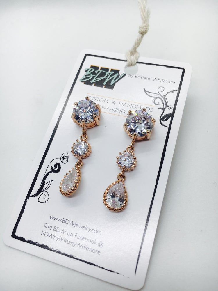 Image of Rose gold and CZ graduated teardrop earrings