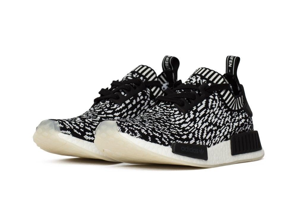 "Image of adidas NMD R1 Primeknit ""Zebra Pack"" Black"