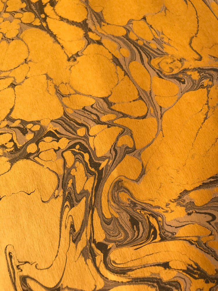 Image of Golden Yellow Base Paper with traditional Marble Stone effect
