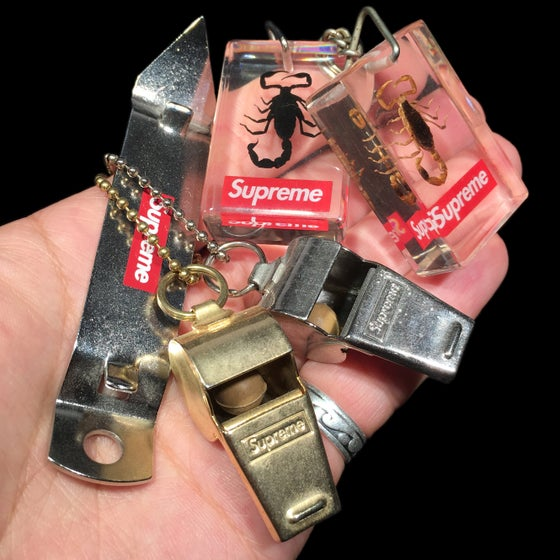 Image of 2010 Bottle Opener, Scorpion Keychains, & Whistles