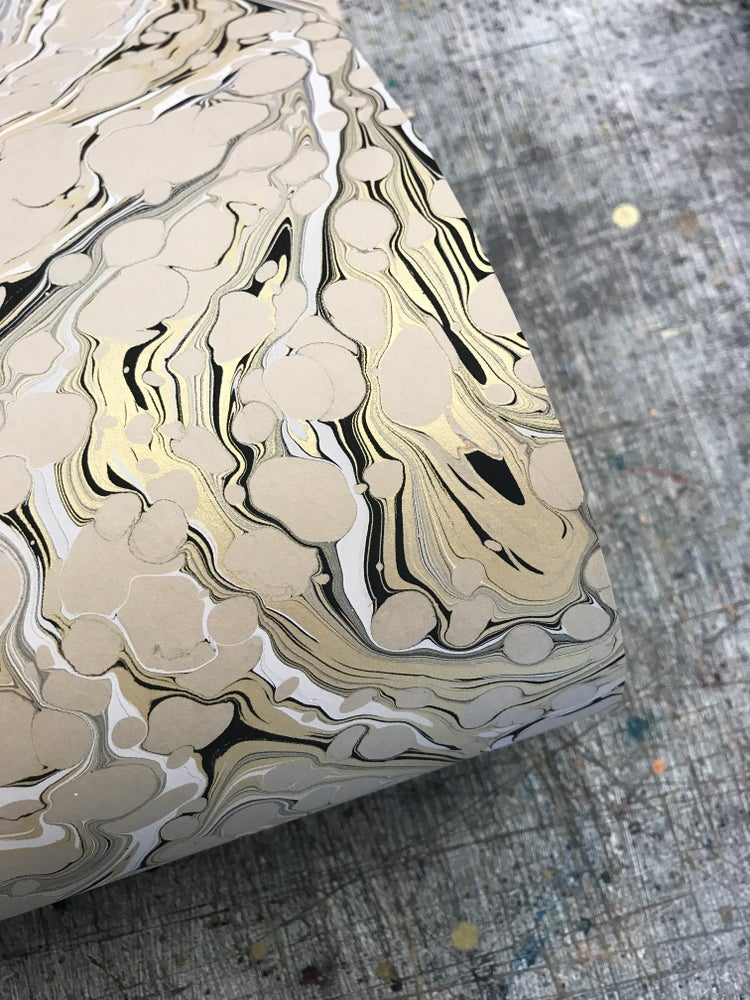 Image of Marbled Fawn paper with gold, black and white vein