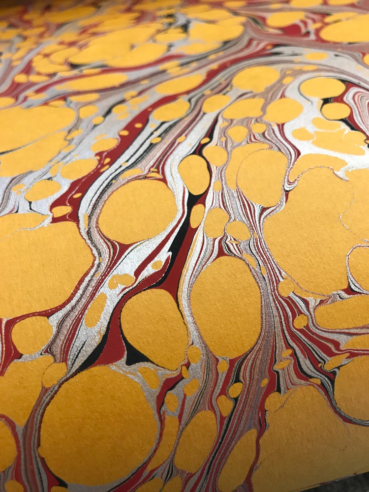 Image of Silver and red on Golden Yellow base paper