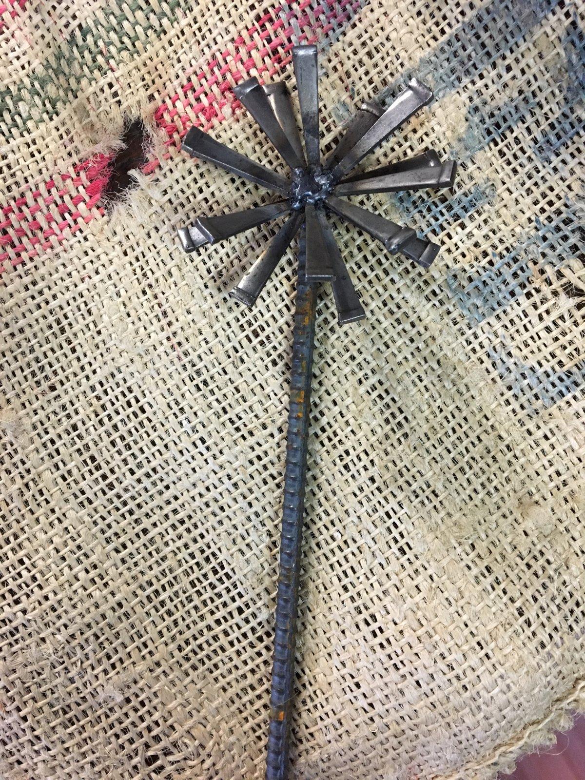 Image of Rebar and masonry nail flower