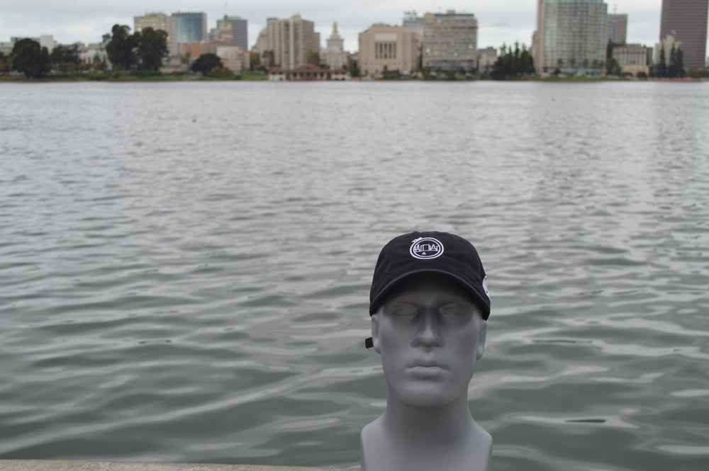 Image of Black and white polo cap.