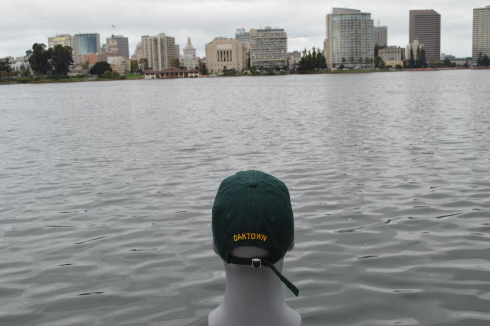 Image of Hunter green and gold polo cap.