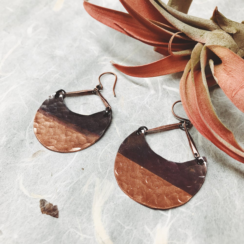 Image of Tapa crescent earrings in copper + patina