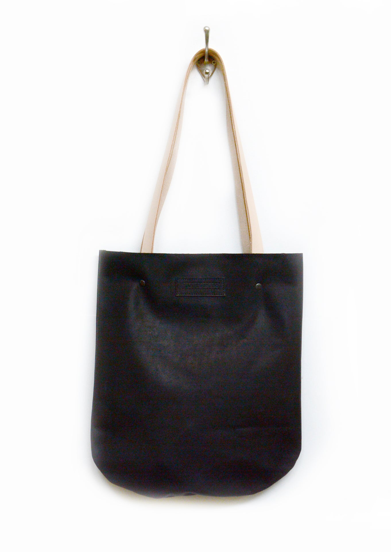 Image of Curved Black Leather Tote Bag