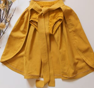 "Image of Bow Waist Cape in ""Marigold"""