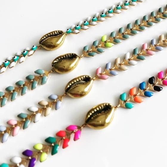 Image of Chevron Brass Cowrie bracelet