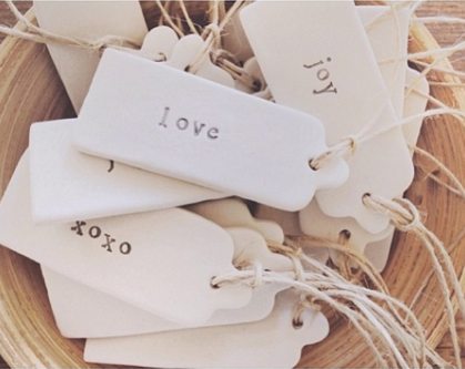 Image of rustic word clay swing tag