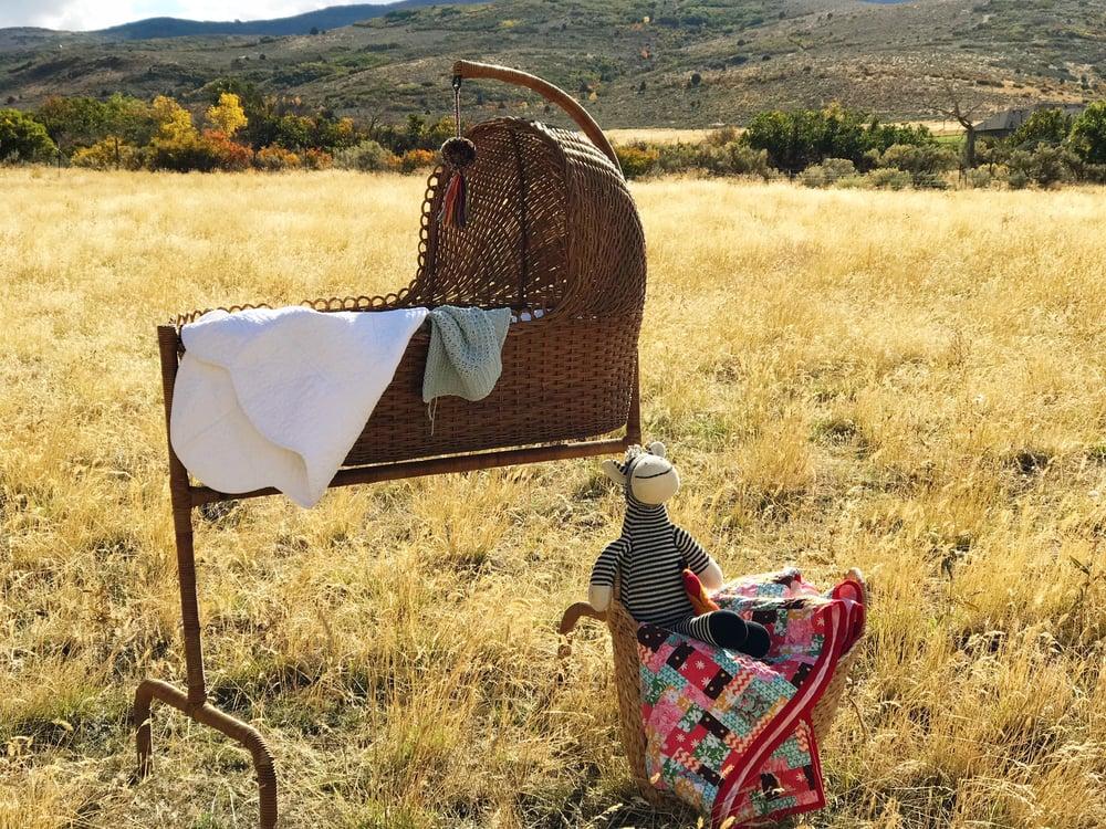 Image of Heirloom wicker cradle