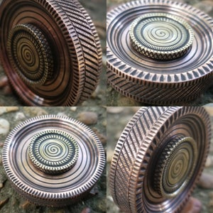 Image of Nibiru Hand Spinner in Either Antiqued Brass or Antiqued Copper