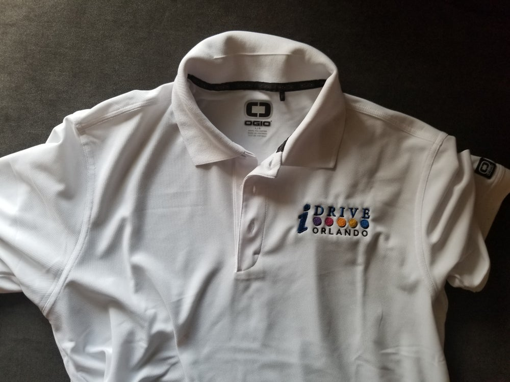 Image of OGIO White Golf Polo Shirt with IDrive Orlando Logo