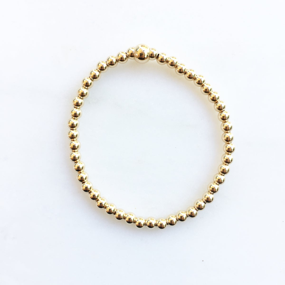 Image of TenThings. Small. 4mm GOLD. Beaded. Bracelet. B-GLDBD4MM