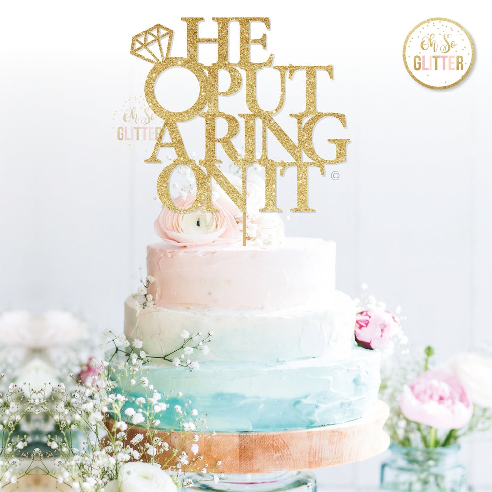 Image of He put a ring on it cake topper