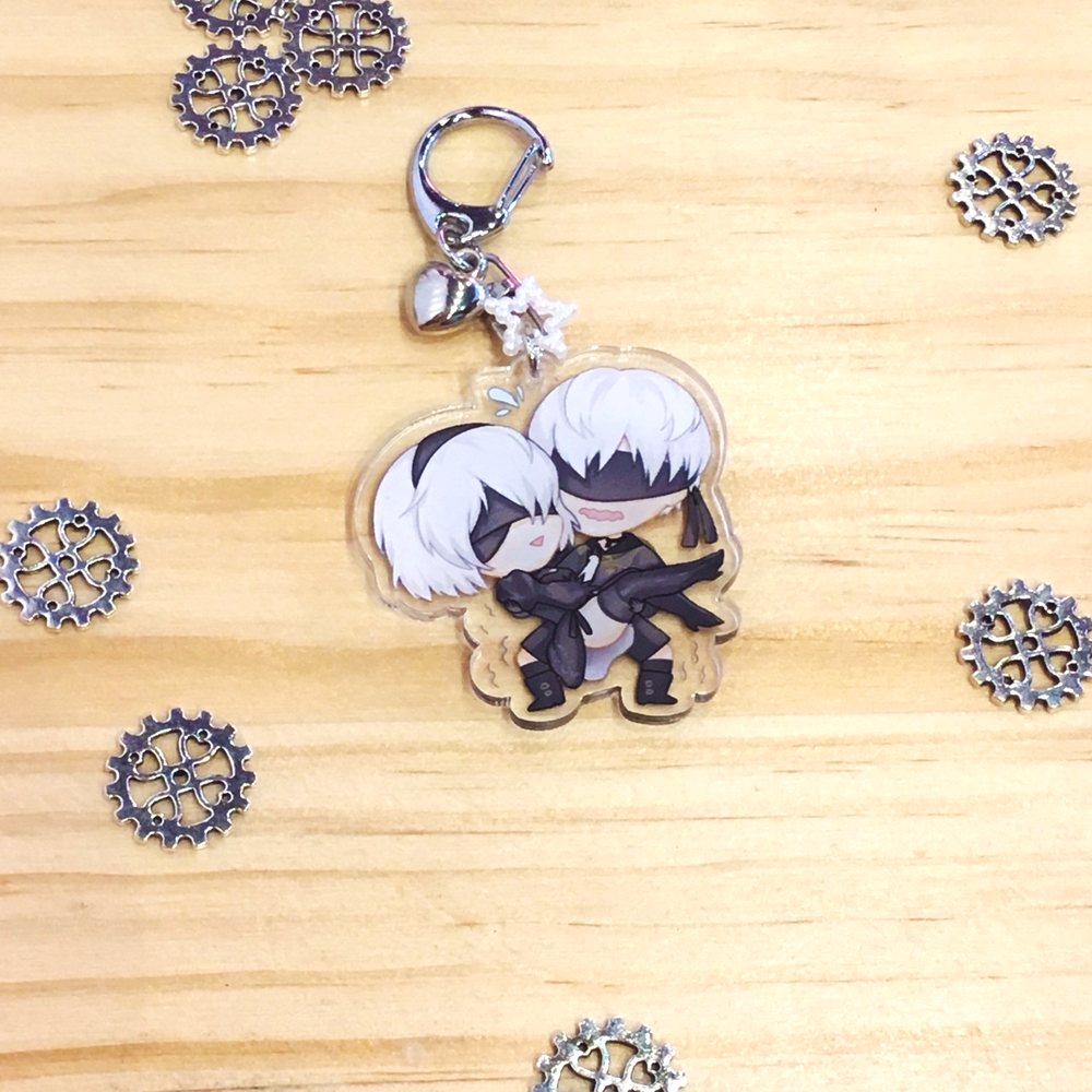 Image of 9S carrying 2B charm!!
