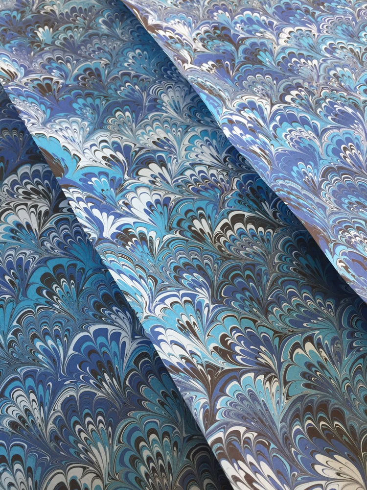 Image of Marbled Paper - Blues peacock design on dark turquoise paper