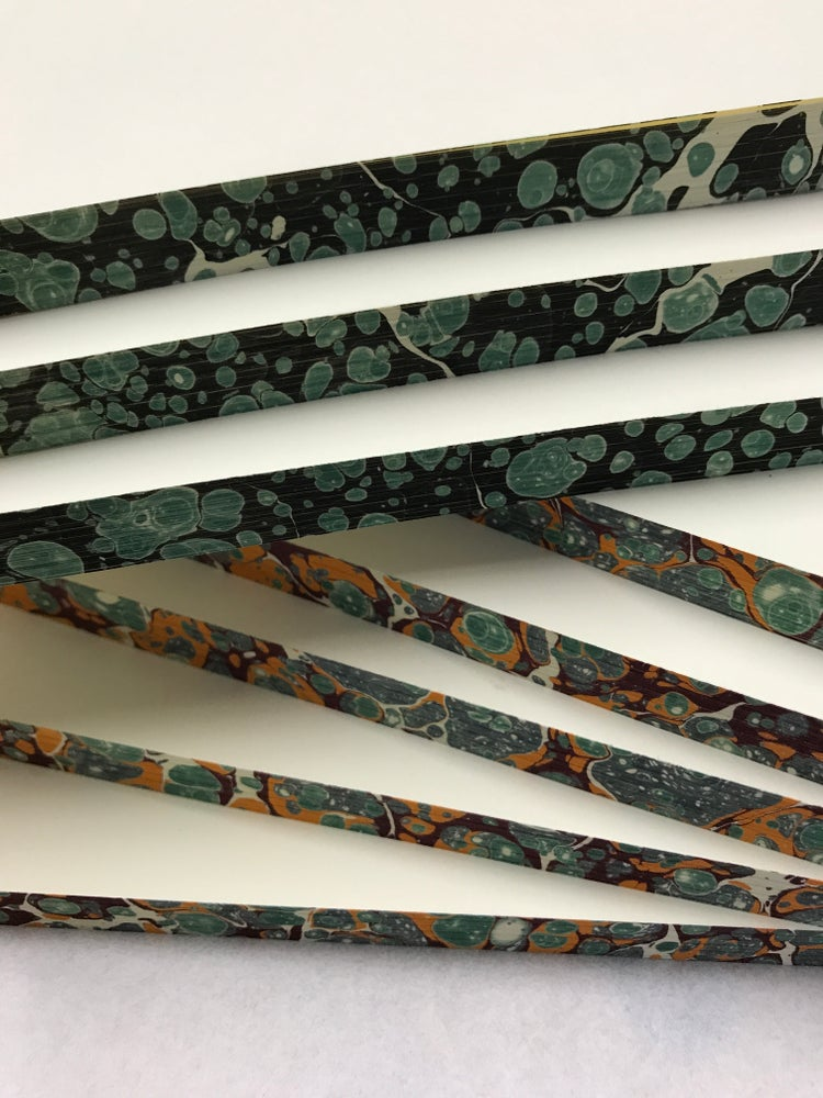 Image of 30 x A5 sized PLAIN (un-ruled) bookblocks with MARBLED EDGES