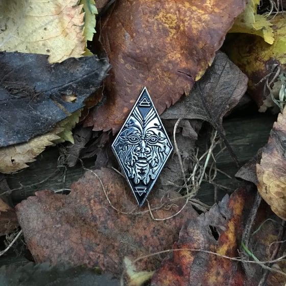 Image of Green man enamel pin.