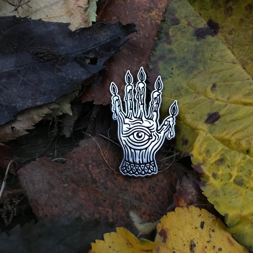 Image of Hand of glory enamel pin.