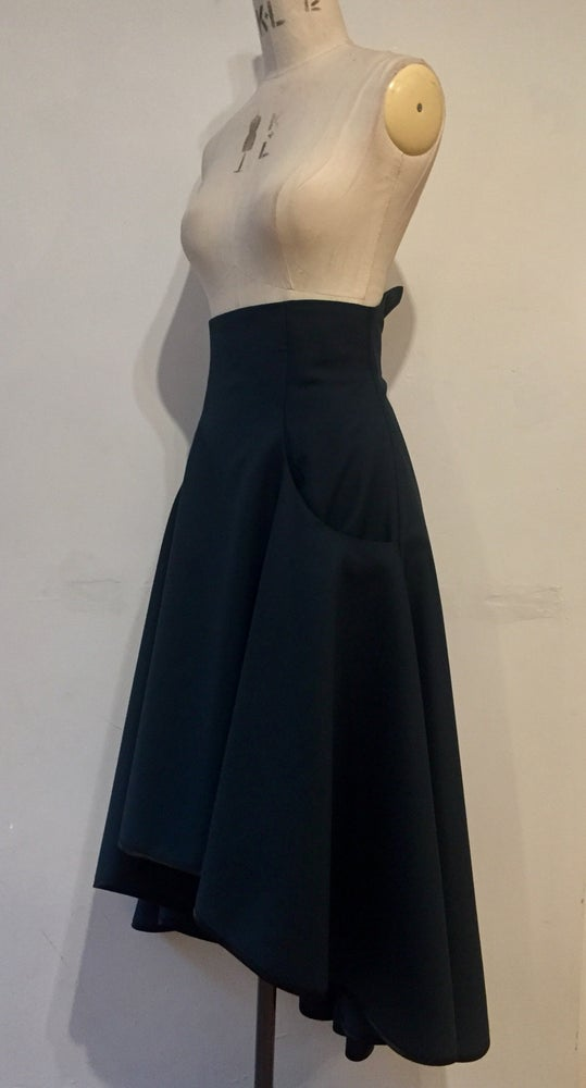 Image of High waisted flare skirt with dipped hem
