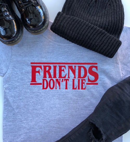 Image of FRIENDS DON'T LIE Tee & Sweater