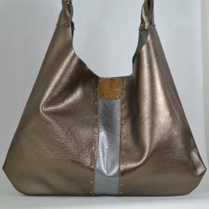 Image of mixed metal cross body