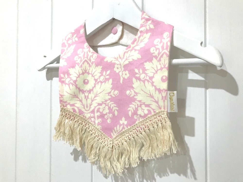 Image of Boho Tassle Bib - Pink Wallpaper
