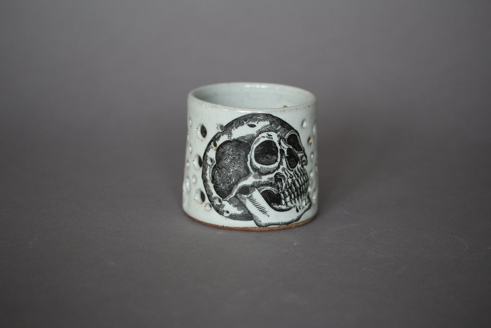 Image of Moth and skull candle holders.