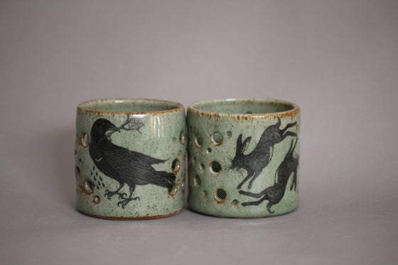 Image of Hare and rook candle holder.